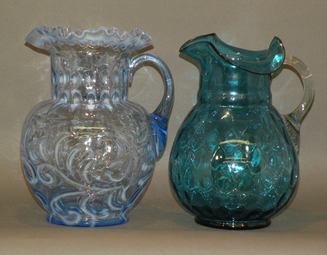 101: 2 blue glass pitchers