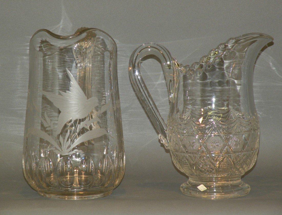 104: 2 clear pattern glass pitchers