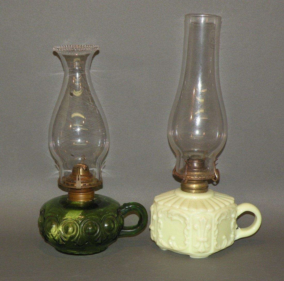 116: 2 green kerosene lamps