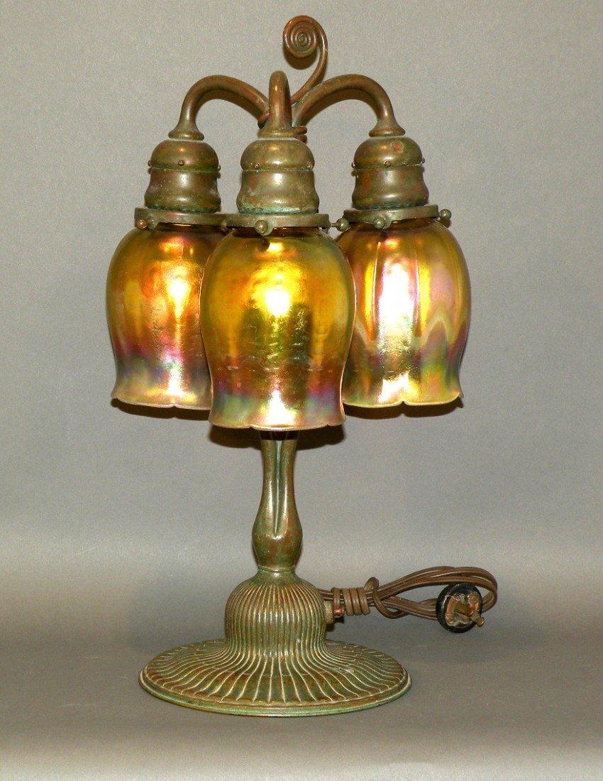 130: Tiffany Studio three light table lamp