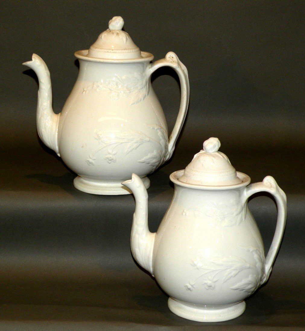 147: 2 white ironstone covered teapots
