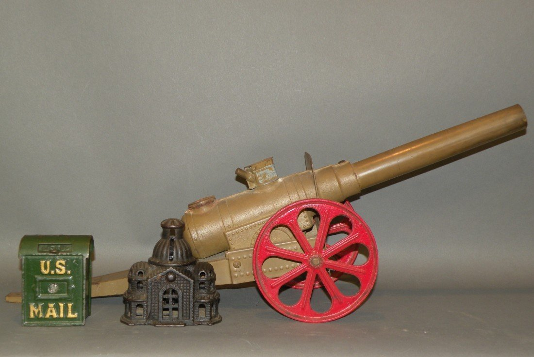 371: 2 cast iron still banks & toy cannon