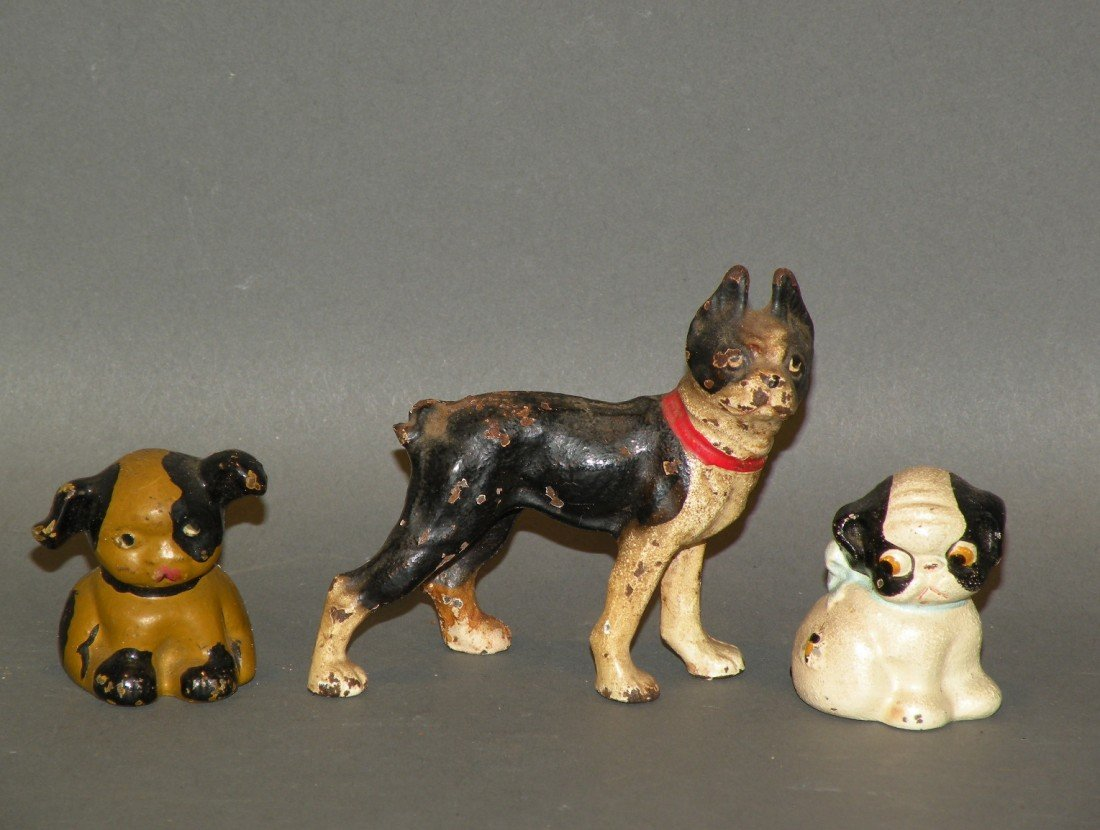 373: 3 small cast iron paperweight dogs