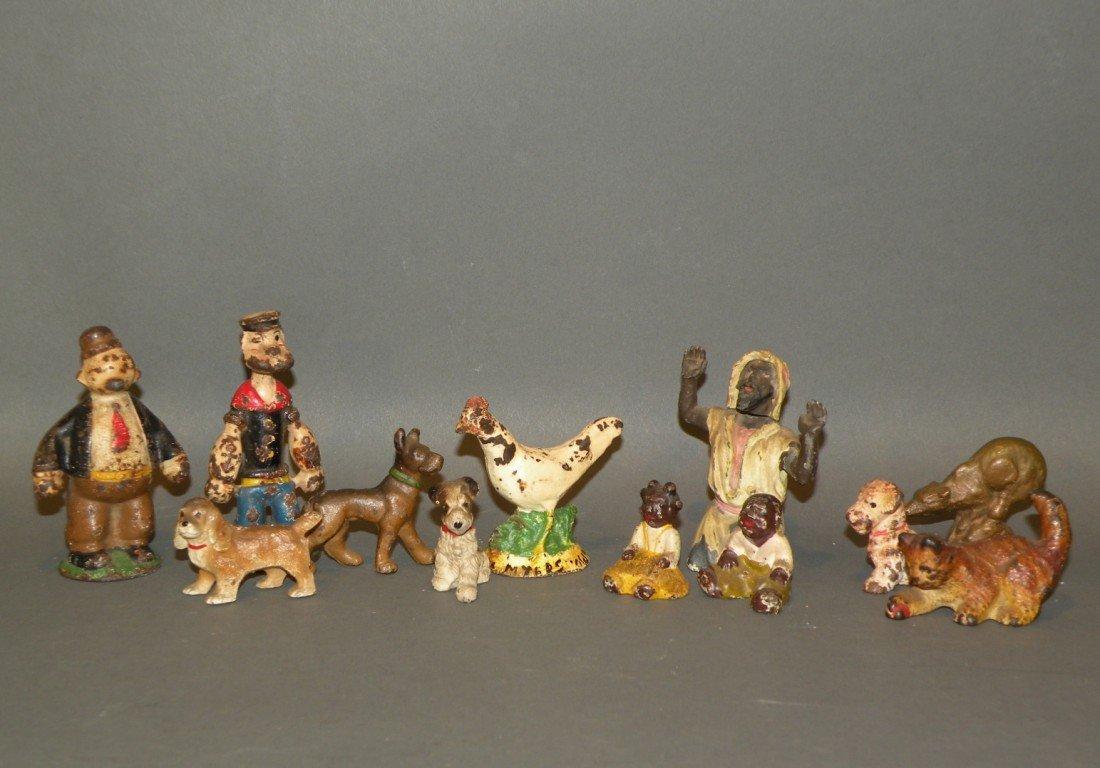 374: 12 mini cast metal figures