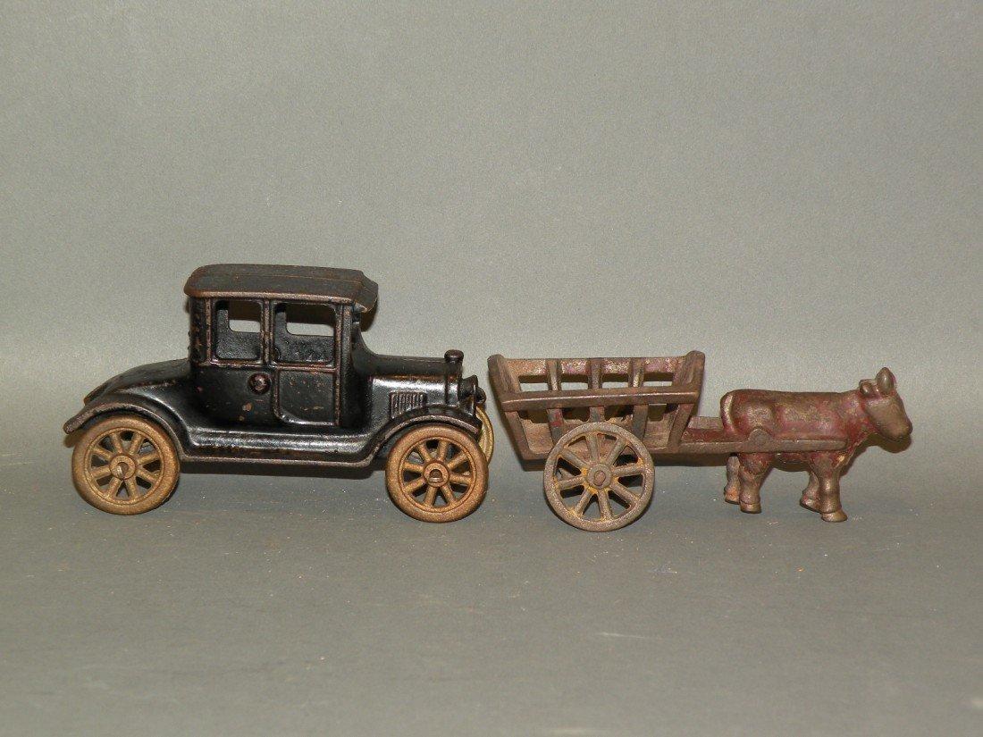 377: 2 cast iron toys