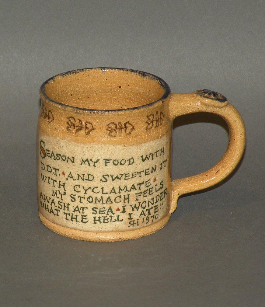 13: Left Handed Russell Henry small mug