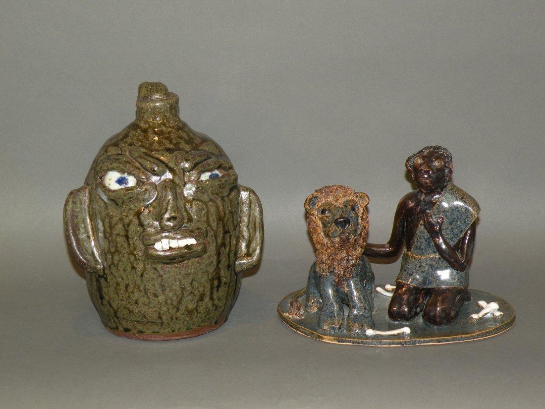 19: Earthenware figure & face jug