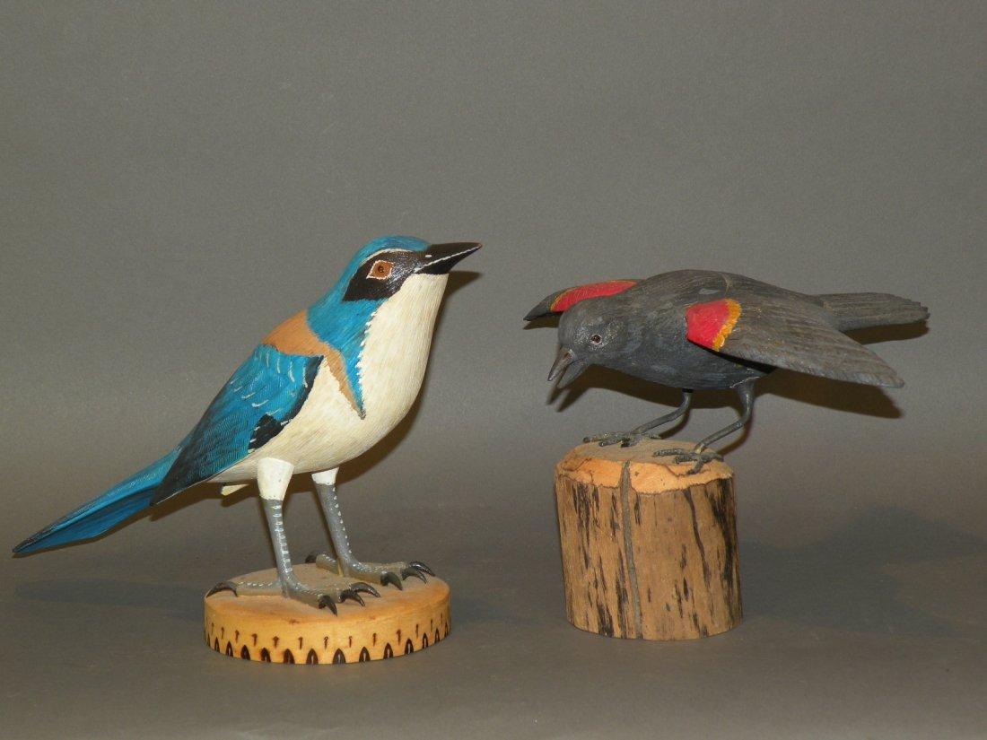 74: 2 bird carvings
