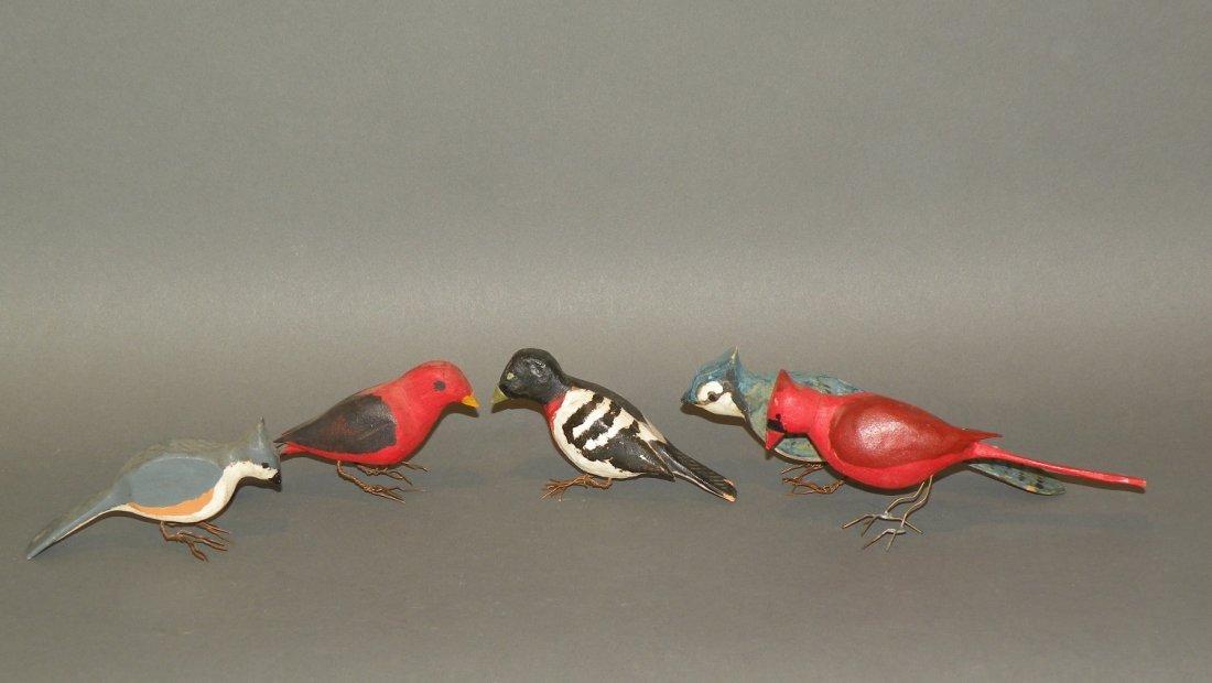 95: 5 carved birds