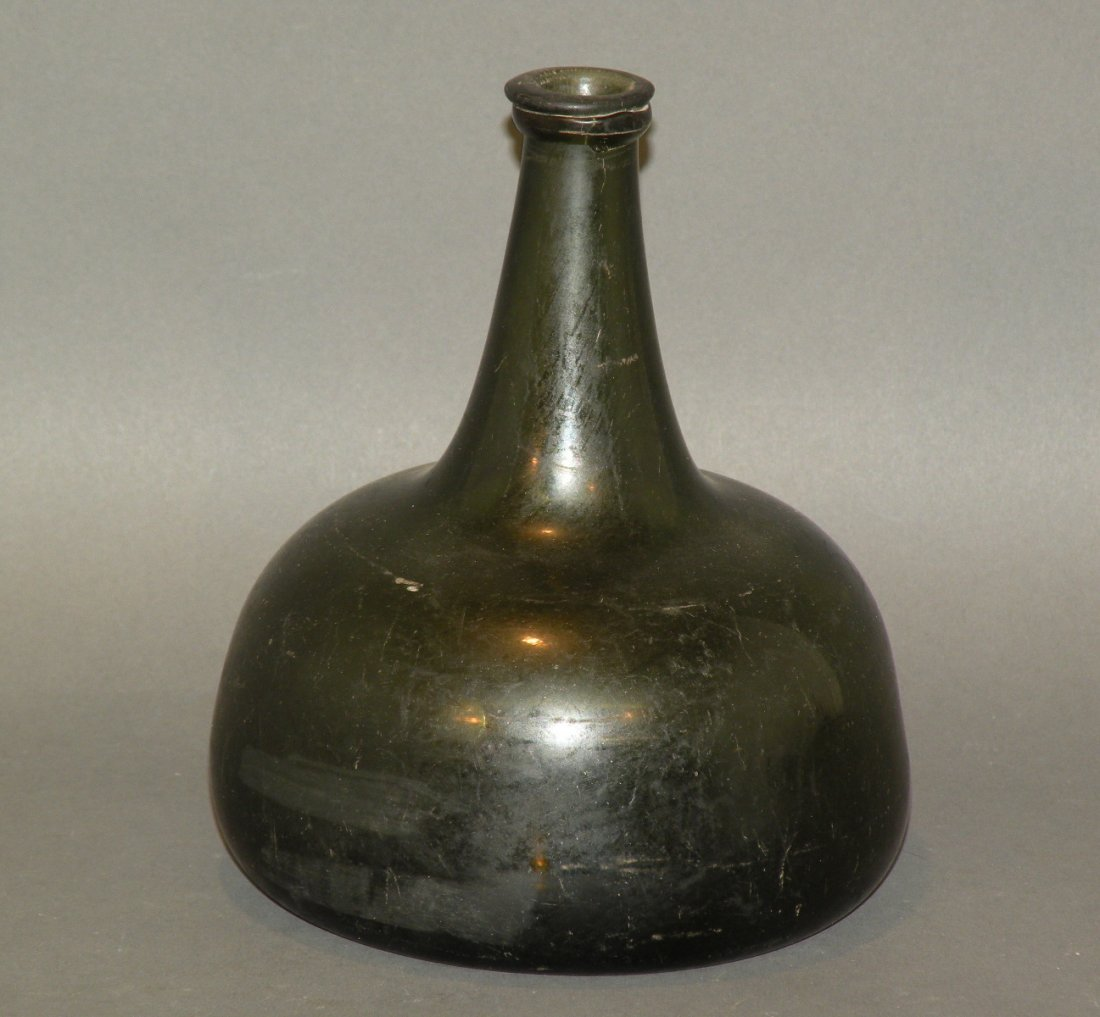 154: Squat blown green glass bottle