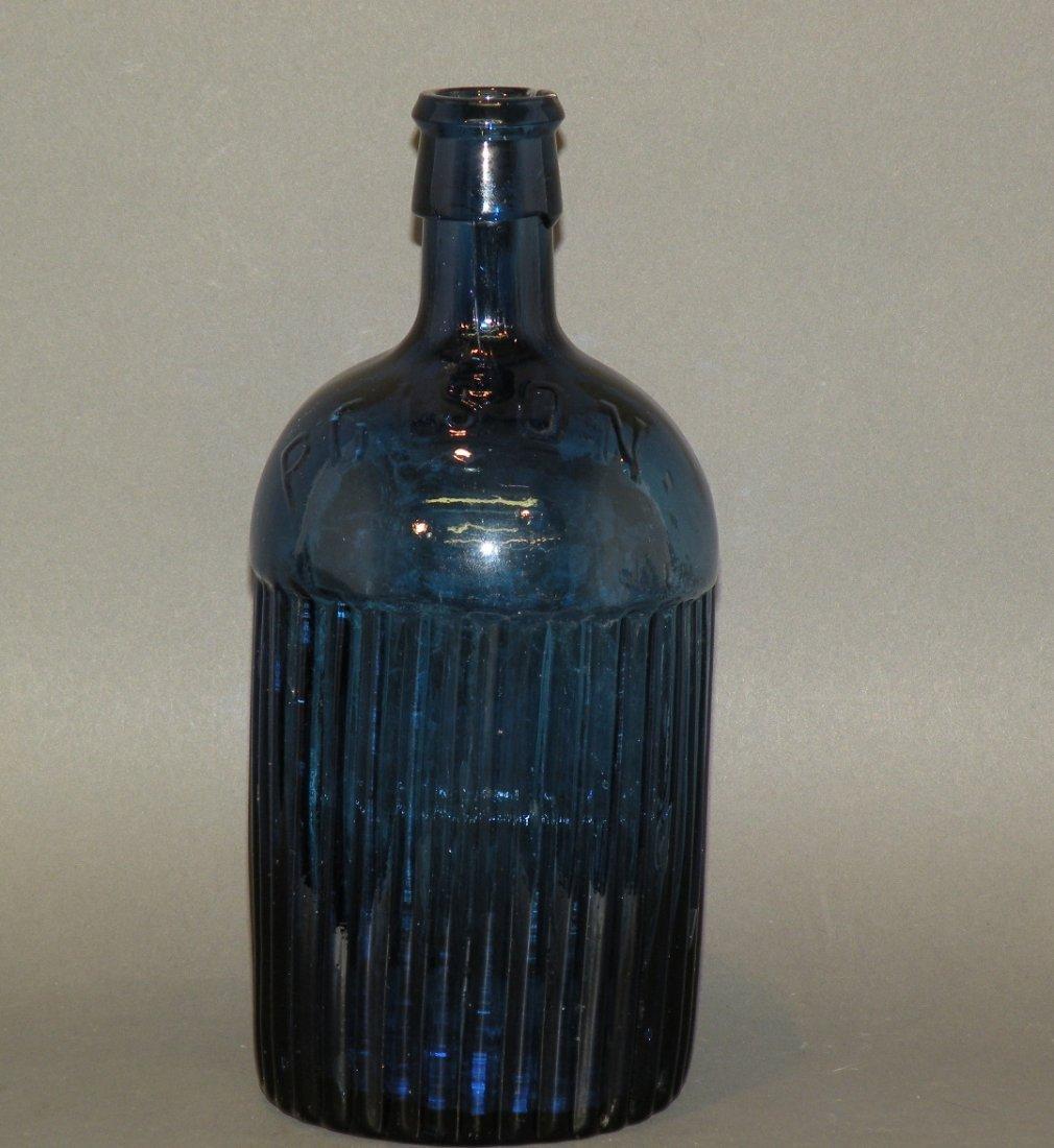 155: Cobalt blown glass poison bottle
