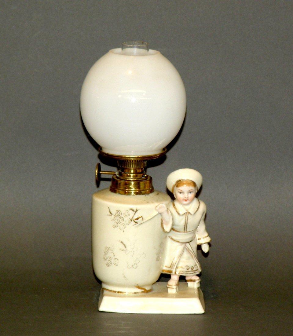 159: Miniature figural based lamp