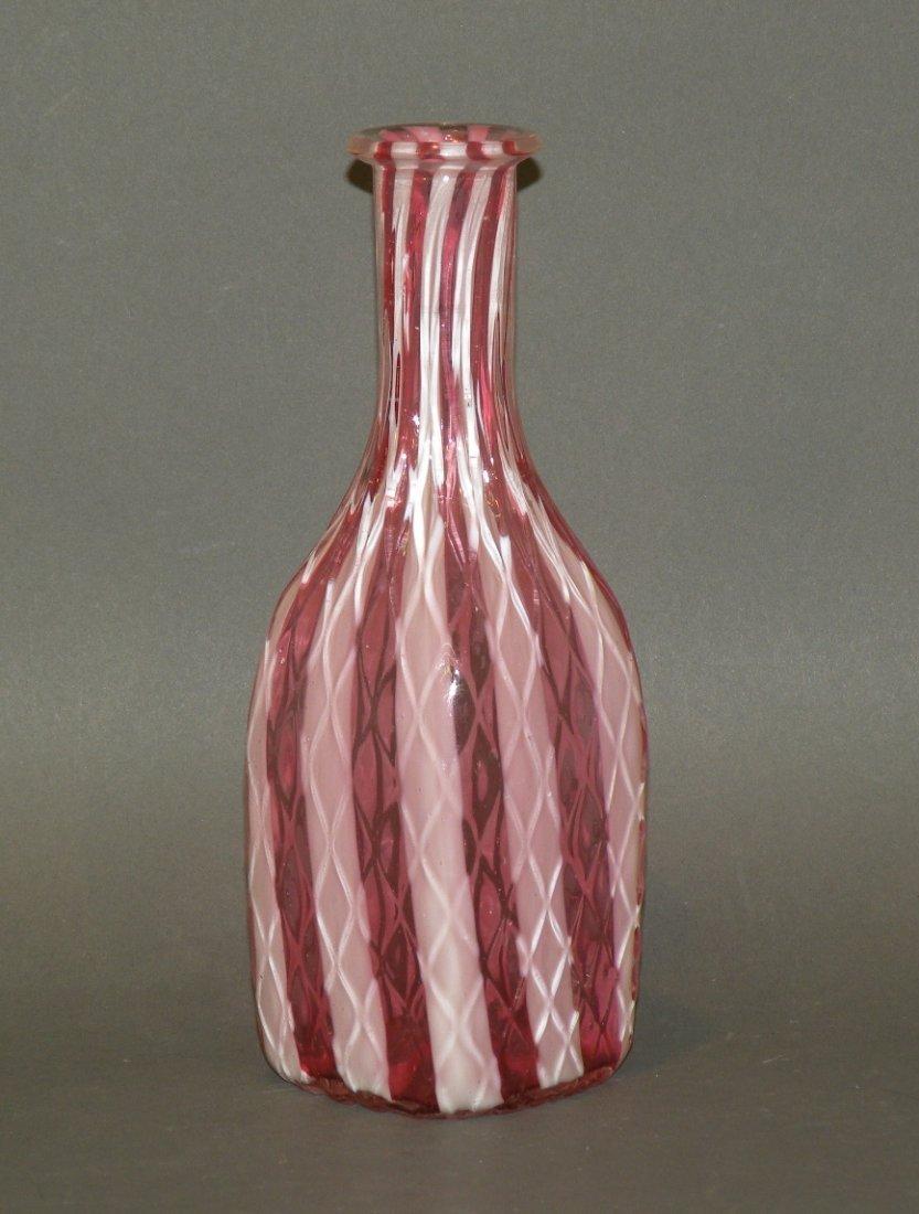 161: Cranberry & milk glass barbers bottle
