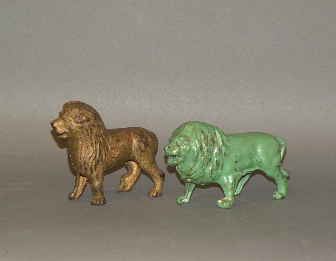339: 2 cast iron lion banks