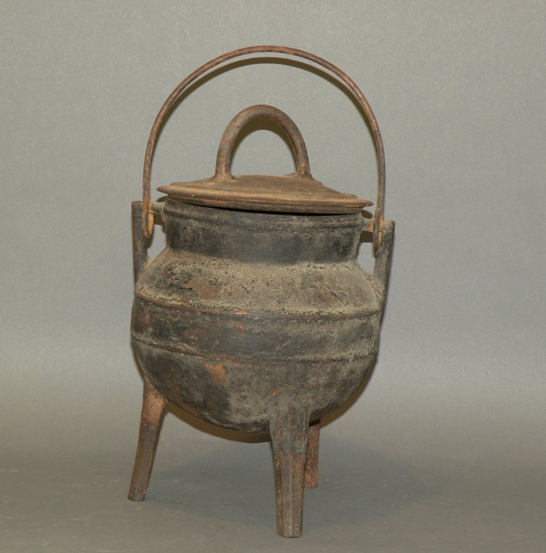 377: Cast iron footed kettle with lid