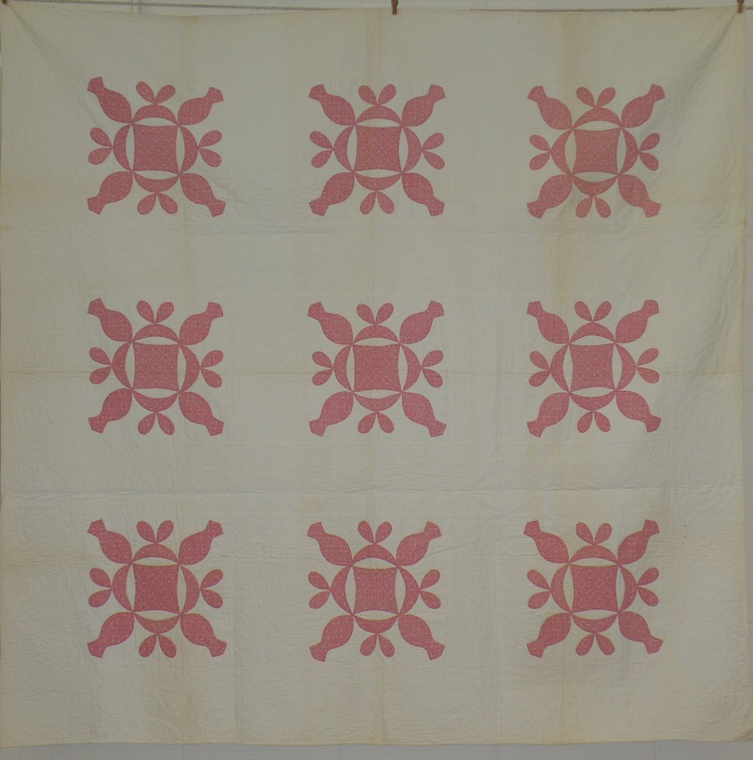 407: Appliqued nine block reel quilt