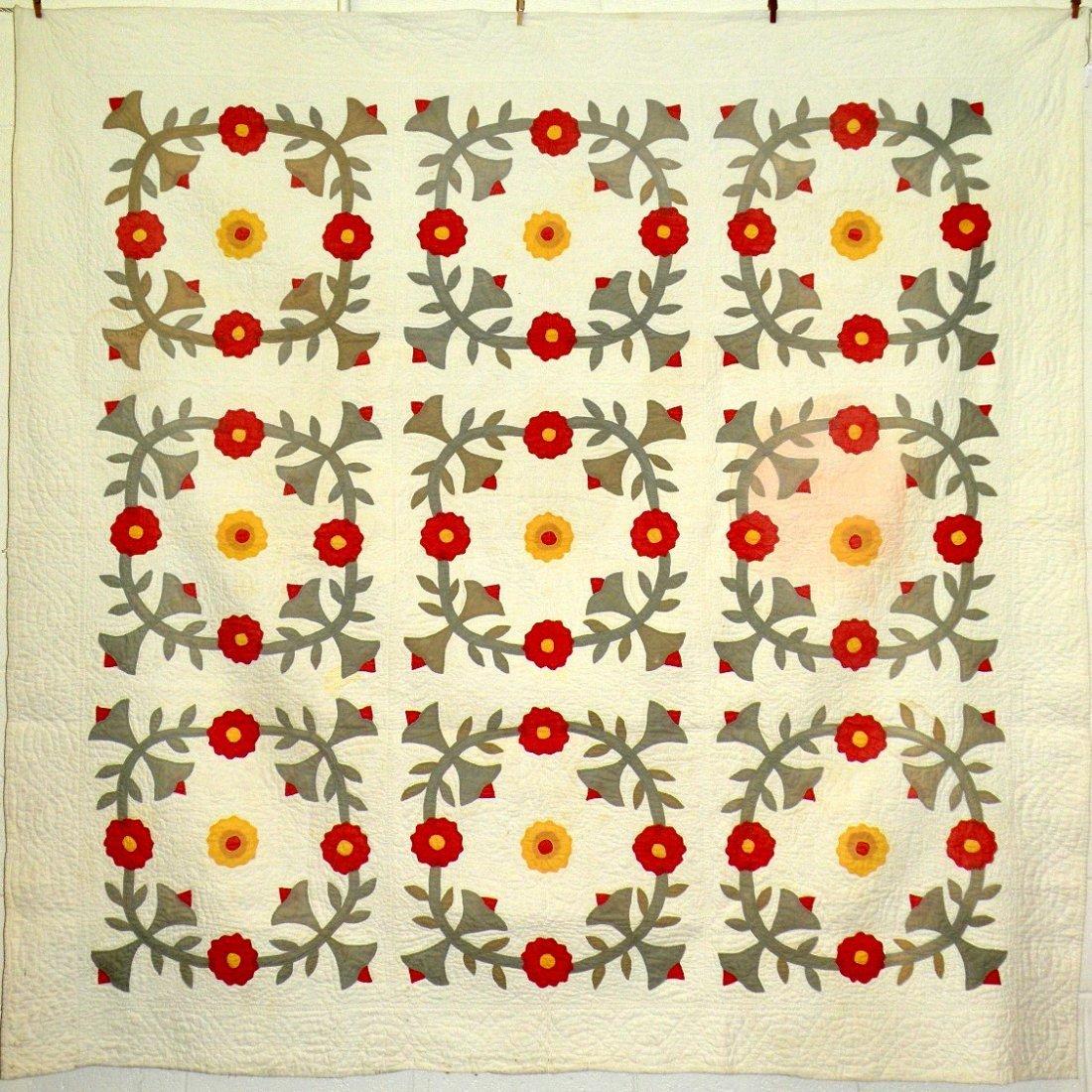 409: Nine block floral wreath appliquéd quilt