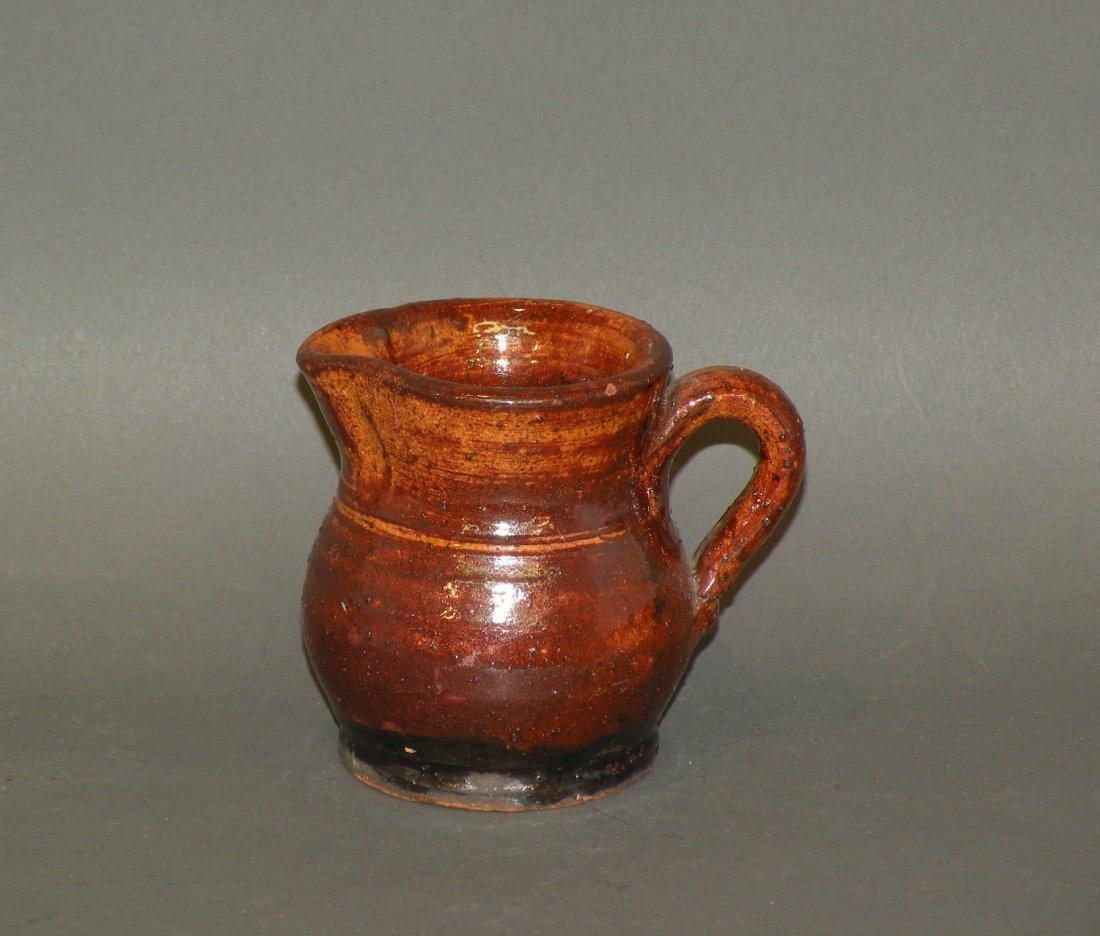 467: Schofield glazed redware creamer