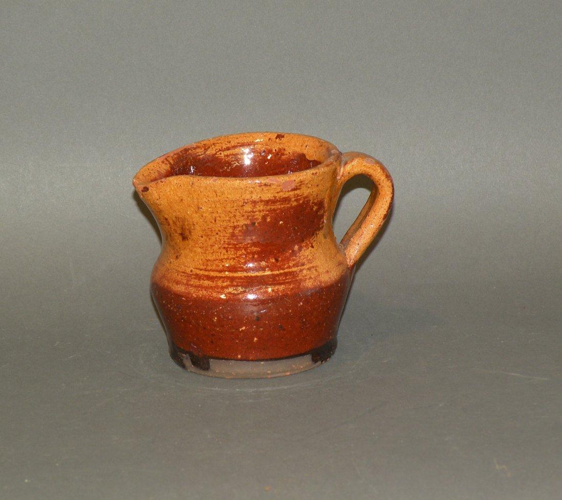 469: Schofield glazed redware creamer