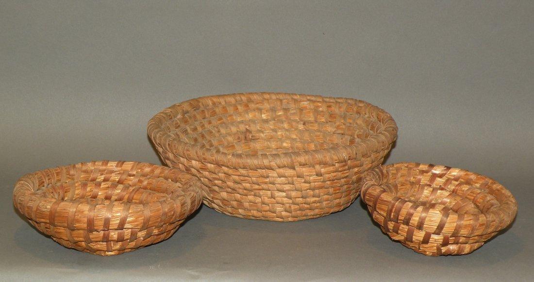 520: 3 rye straw baskets