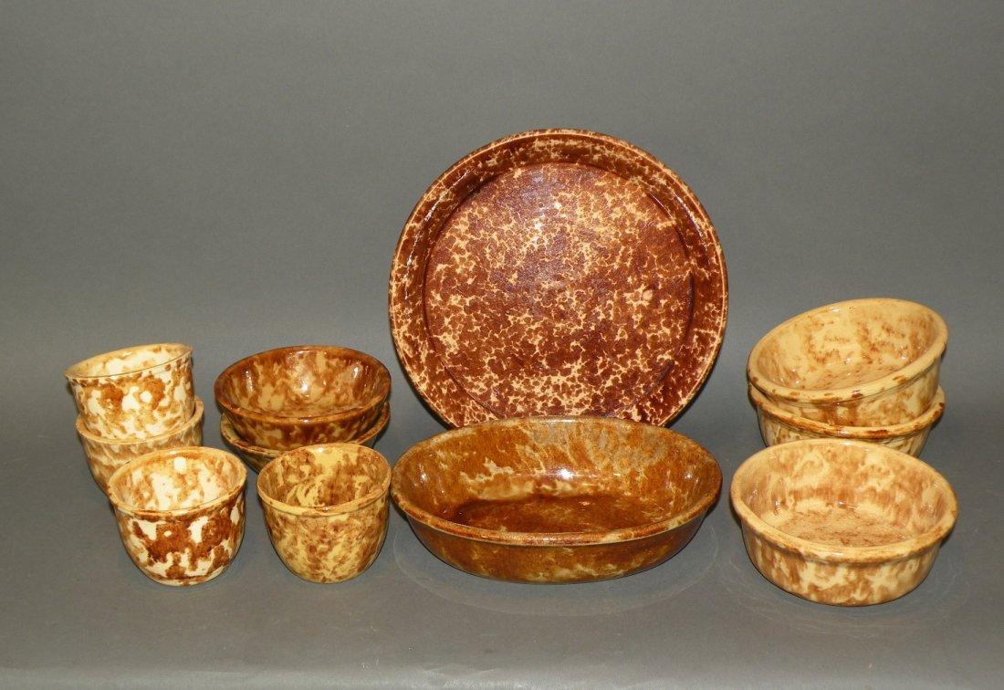 537: 11 pieces Rockingham glazed yelloware