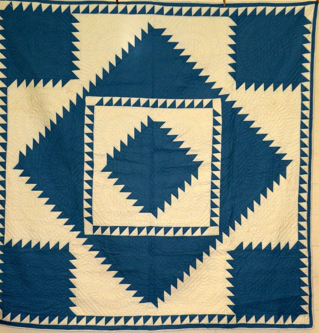 555: Blue & white pieced quilt