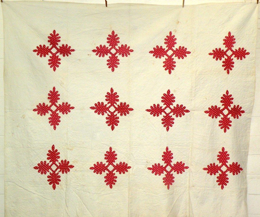 557: 12 block red print appliquéd quilt