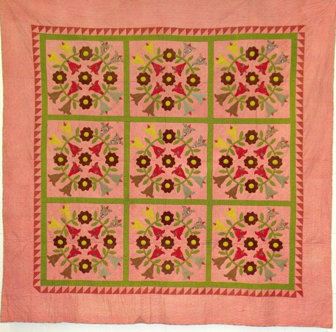 560: Appliqued floral wreath quilt