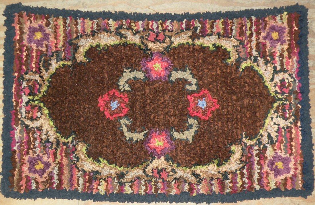 567: Floral hooked rug
