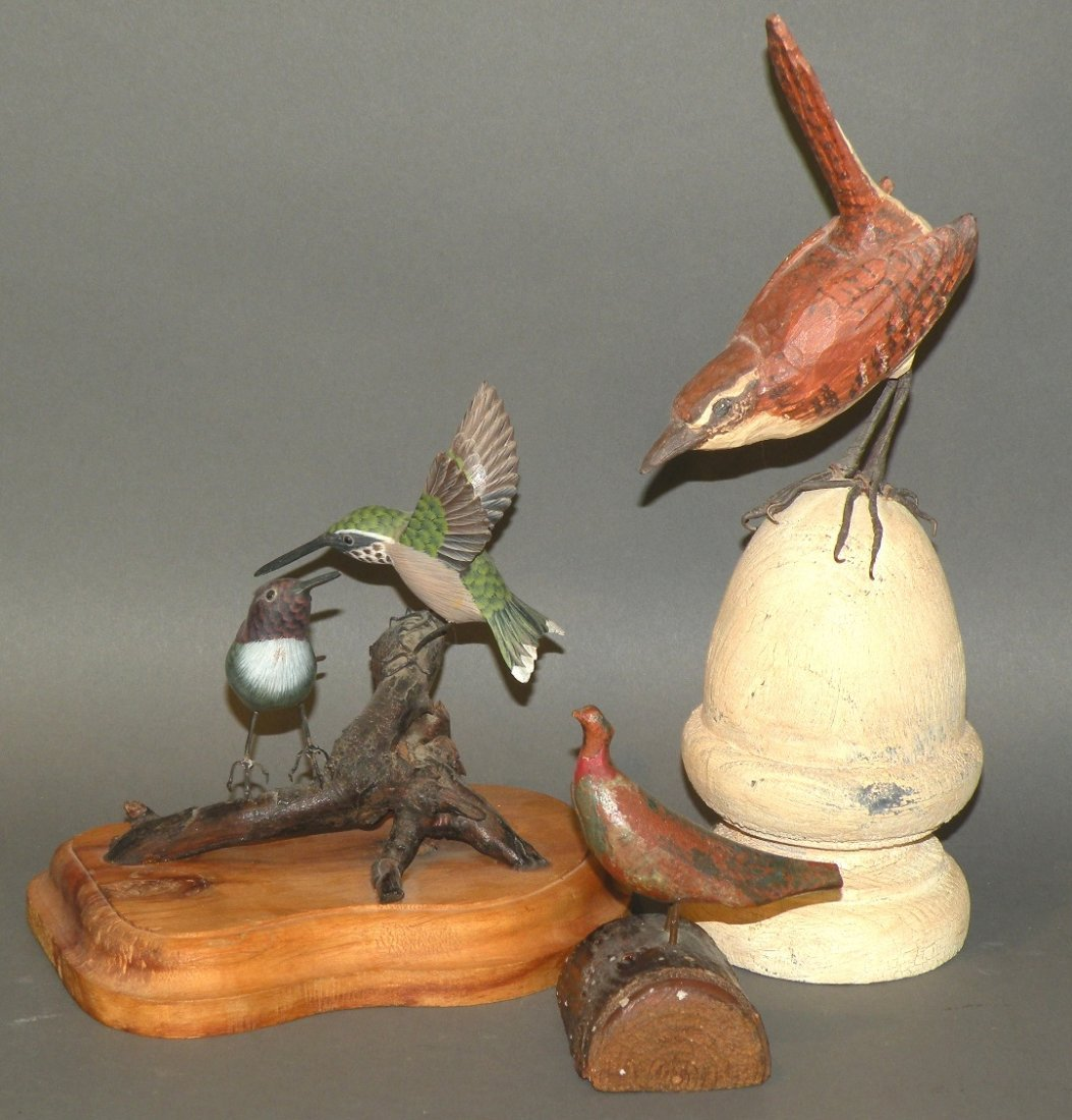 3 bird carvings