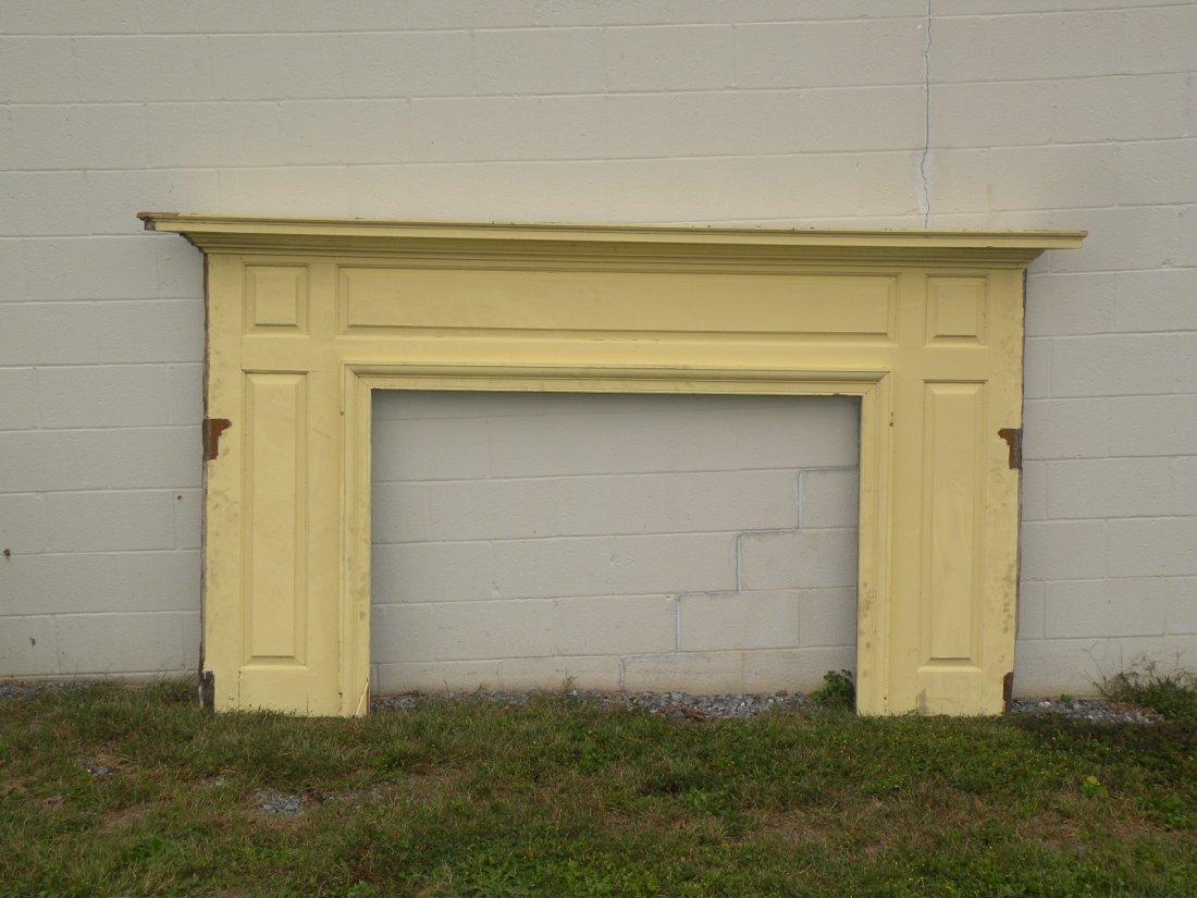 29: Yellow fireplace mantel