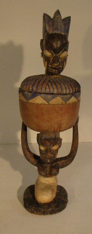 11: Central African carved wood and polychrome figure.