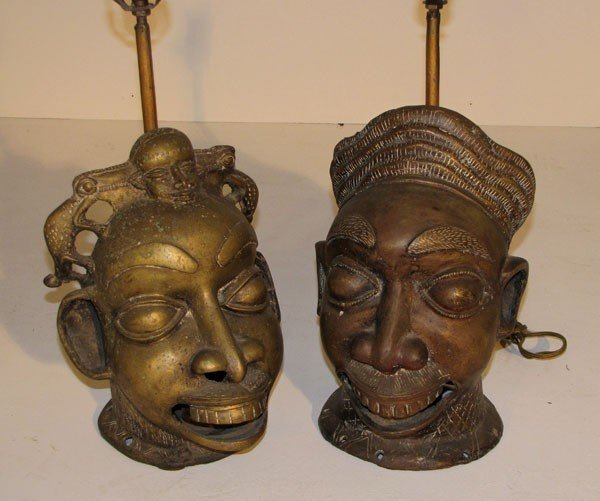 12: Two cast brass African style mask-form lamps.