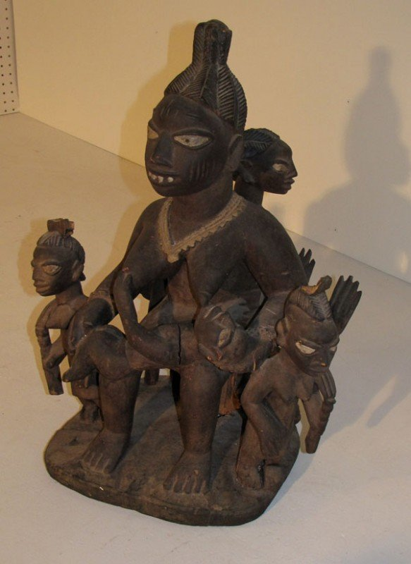 14: African Yoruba carved wood figural group. H: 24""