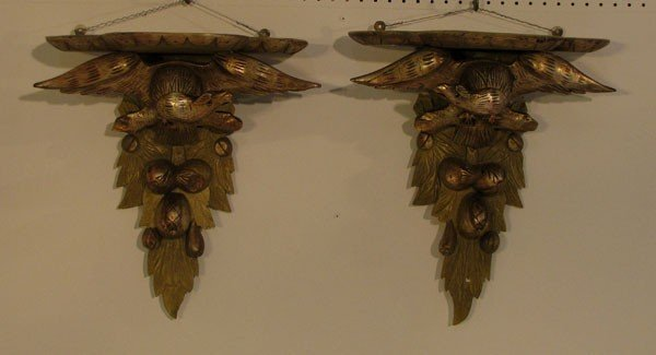 21: Pair of carved gilt-wood eagle-form brackets with g
