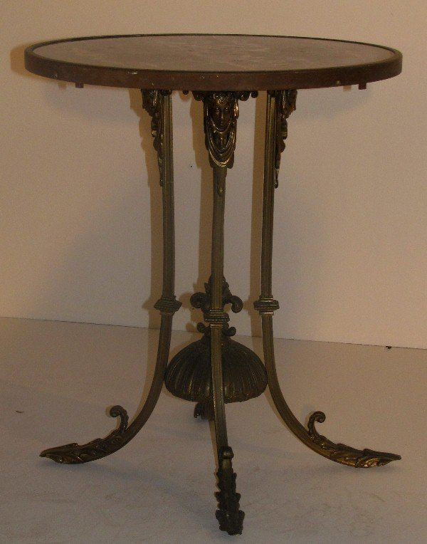 325: Empire style bronze and marble-top table. H: 23 1/