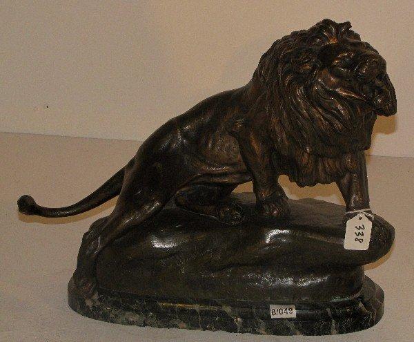 338: European School, bronze model of a lion, signed in