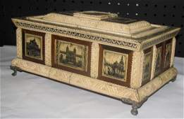 428: Continental carved and stained ivory and wood box