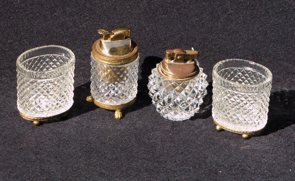 19: Four pieces French crystal cigarette articles.