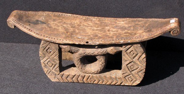 """20: African carved wood low bench. H: 9"""" W: 26"""""""