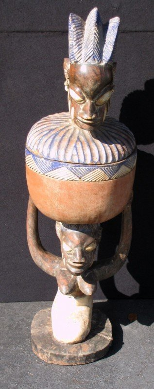 21: African carved and polychrome carved wood figural b