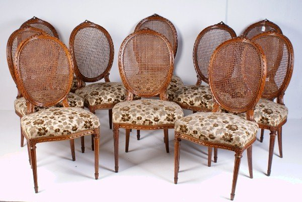 24: Set of 10 Louis XVI style carved walnut dining chai