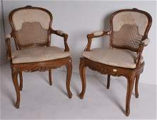 284 Pair of Louis XV style carved walnut fauteuils op