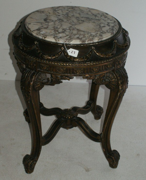 23: Louis XV style carved parcel-gilt marble-top table,
