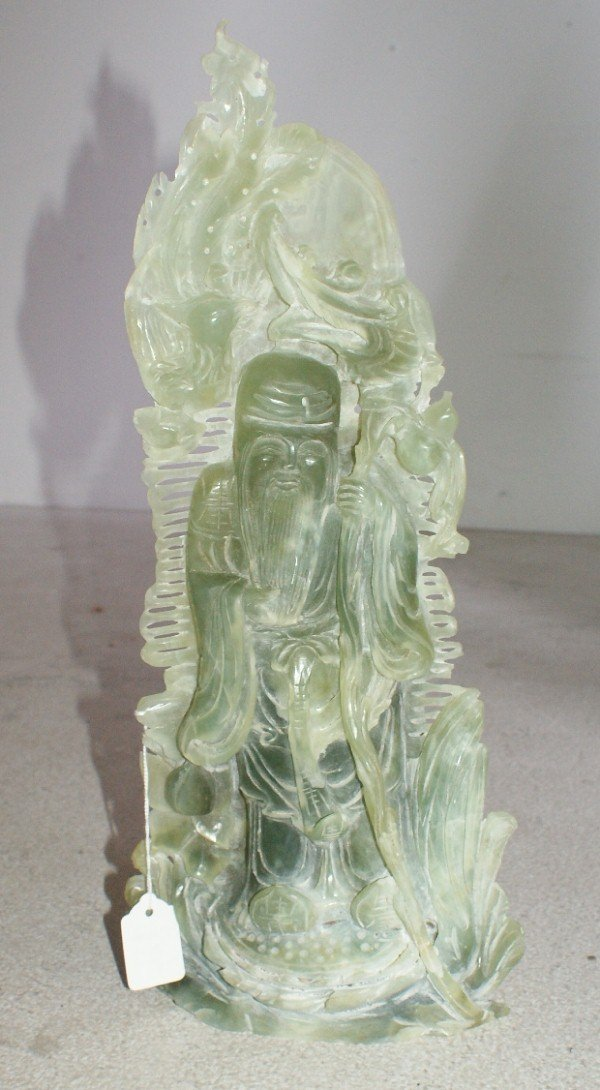 12: Large Chinese carved pale green jadeite figure of a