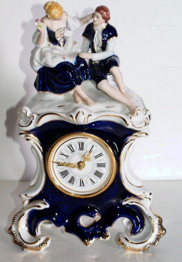 4:   German porcelain figural clock depicting Romance.
