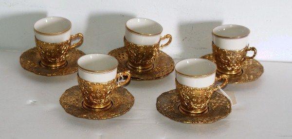 14: Gilt-metal and porcelain demitasse set