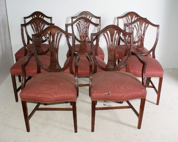 9:  Set of eight mahogany shield back dining chairs. H: