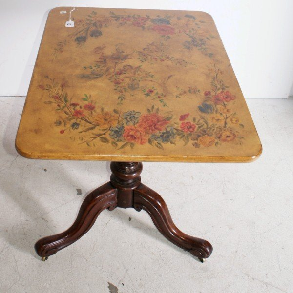 10:  English Victorian tilt-top table with painted top.