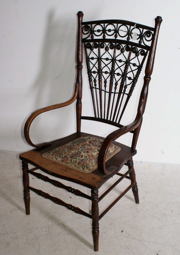 "12:  Victorian oak and wicker armchair. H: 44"" ."